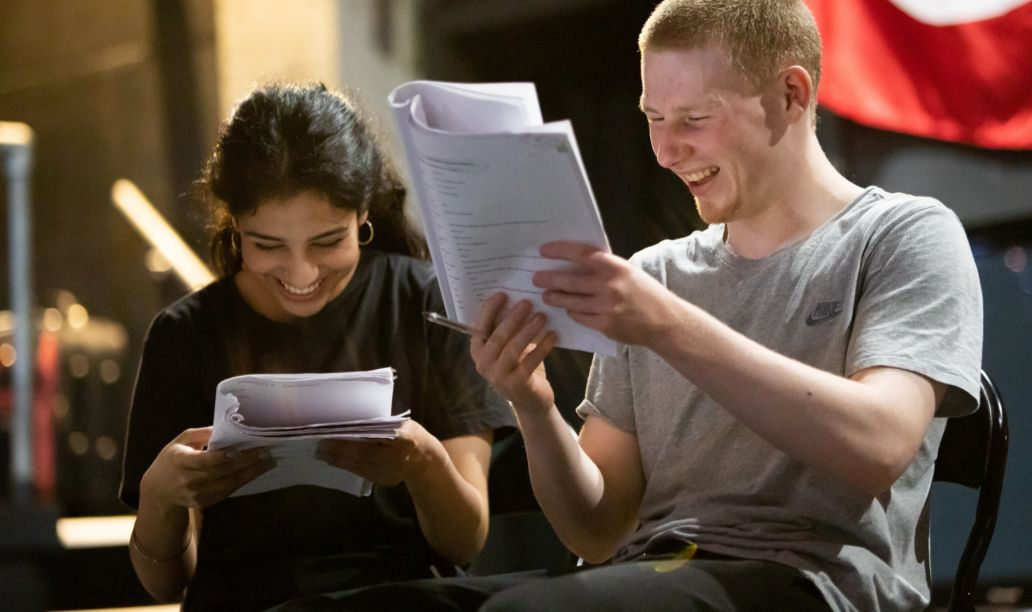 Two students reading script